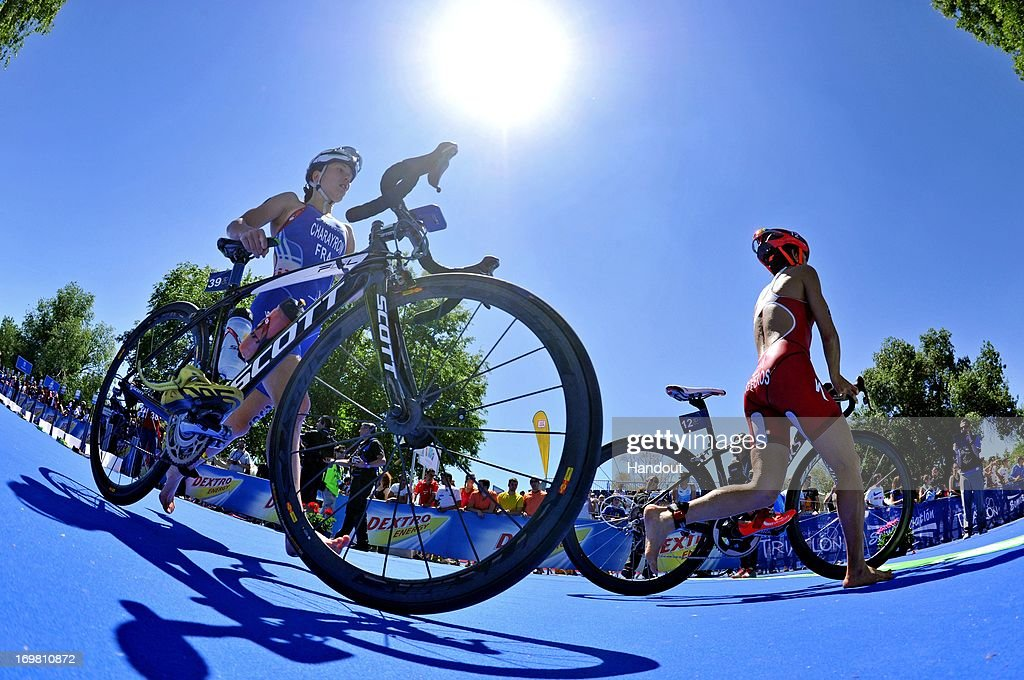 In this photo released by the International Triathlon Union, two athletes head through transition at the ITU World Triathlon on June 1, 2013 in Madrid, Spain.