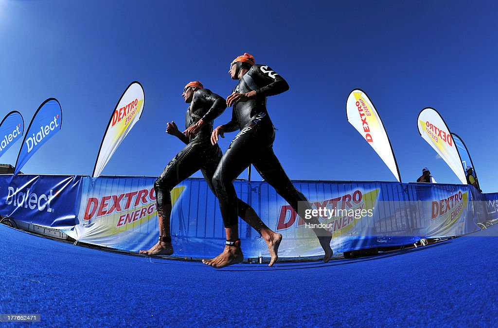 In this photo released by the International Triathlon Union, two men run out of the first swim lap and prepare to dive back into the Baltic Sea at the ITU World Triathlon Stockholm on August 25, 2013 in Stockholm, Sweden.