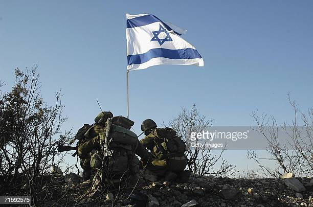 In this photo released by the Israel Defense Forces Israeli soldiers raise their national flag at the army's new Sahlab outpost August 5 2006 in...