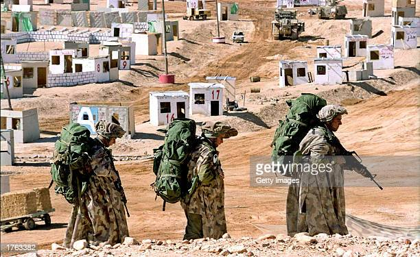 In this photo released February 5 Israeli infantry troops conduct training exercises in a mock village constructed on a military base in southern...