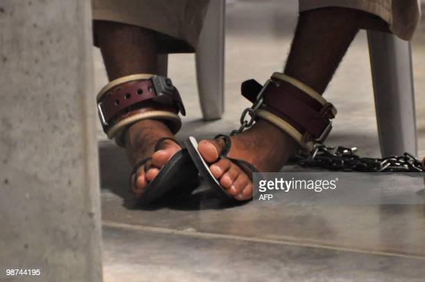 In this photo reviewed by a US Department of Defense official a Guantanamo detainee's feet are shackled to the floor as he attends a 'Life Skills'...