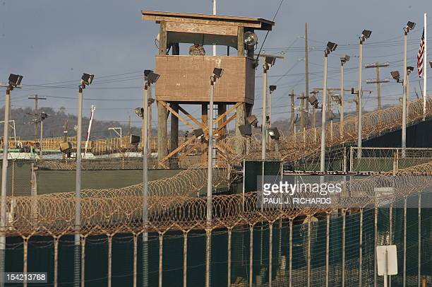 In this photo reviewed by US military officials a US military member mans one of the watch towers at Camp Delta at the US Detention Center in...