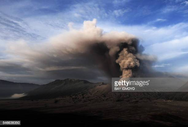 TOPSHOT In this photo taken from Probolinggo in Indonesia's East Java province Mount Bromo spews ashes into the air during a volcanic eruption on...
