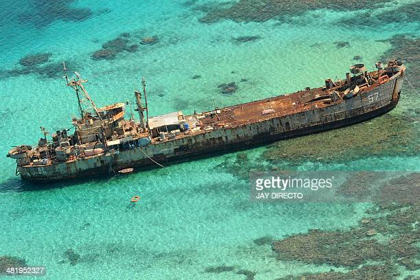 In this photo taken March 29 an aerial view shows a Philippines Navy vessel that has been grounded since 1999 to assert the nation's sovereignty over...