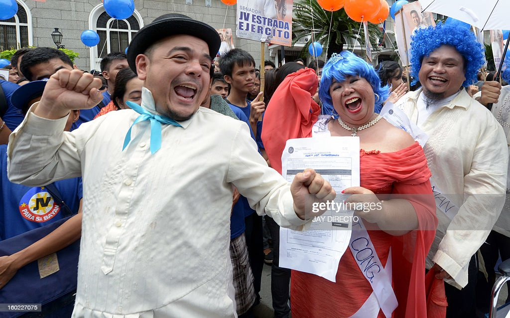 In this photo taken October 1, 2012, Filipino activist Carlos Celdran (L) gestures during a rally in front of the Commission on Election about political dynasty in Manila. Celdran a social activist in the Catholic Philippines said he faced up to 13 months in jail after being found guilty of 'offending religious beliefs' for speaking out in favour of birth control. AFP PHOTO / Jay DIRECTO