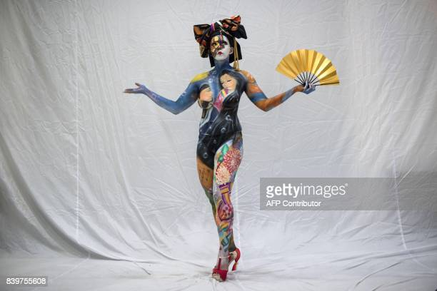 In this photo taken on August 26 a model representing a contestant from Japan poses backstage during the Daegu International Bodypainting Festival in...