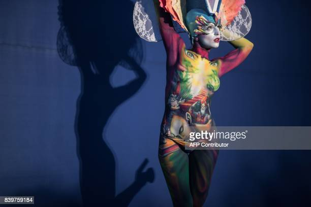 In this photo taken on August 26 a model representing Emanuele Borello of Italy poses during the Daegu International Bodypainting Festival in Daegu...