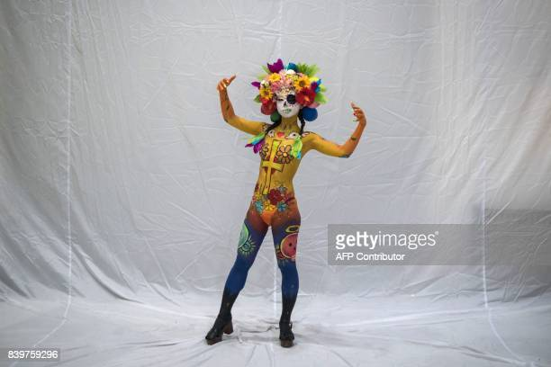 In this photo taken on August 26 a model showcases a design by Fumiko Tamaura of Japan during the Daegu International Bodypainting Festival in Daegu...
