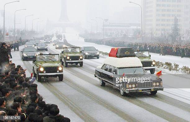 In this photo taken on December 28 2011 shows a car carrying the casket containing Kim JongIl during the funeral procession in Pyongyang Millions of...