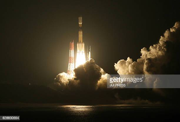 In this photo taken on December 9 Japan's HIIB rocket launches from the Tanegashima Space Center in Tanegashima island Kagoshima prefecture The HTV6...