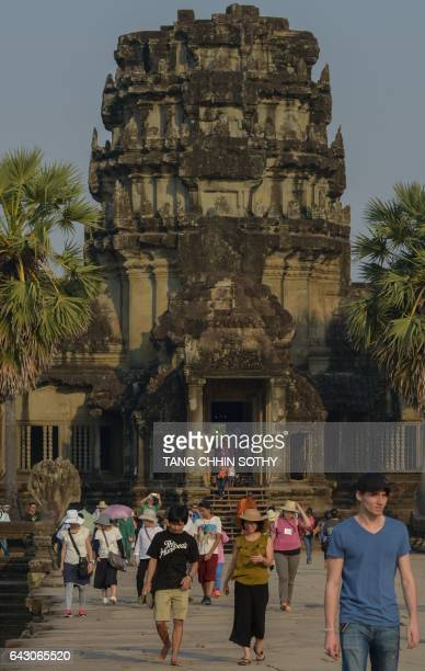 In this photo taken on February 17 Maddox JoliePitt the adopted son of Angelina Jolie visits the Angkor Wat temple in Siem Reap Angelina Jolie...