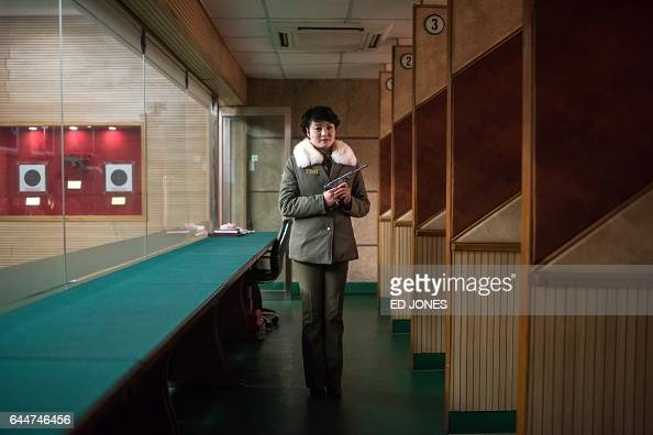 TOPSHOT In this photo taken on February 21 shooting instructor Kim SuRyon poses for a portrait at the Meari Shooting Range in Pyongyang Kim is...