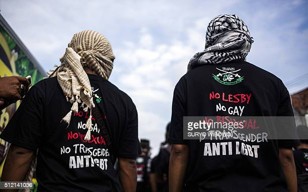 TOPSHOT In this photo taken on February 23 2016 shows antiLGBT Muslim group marching to blockade proLGBT protesters in Yogyakarta in Java island The...