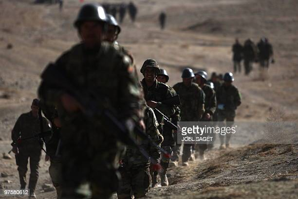 In this photo taken on January 13 Afghan National Army trainee officers march with M16 American assault rifles during training with the French army...