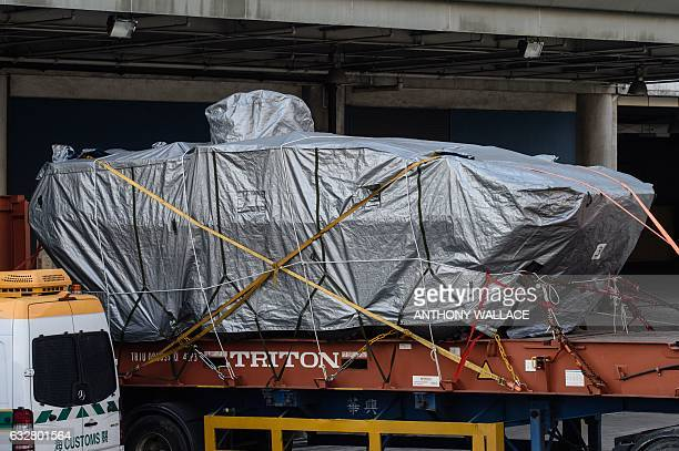 In this photo taken on January 26 one of seven impounded tarpaulincovered armoured troop carrier Terrex vehicles belonging to the Singapore military...