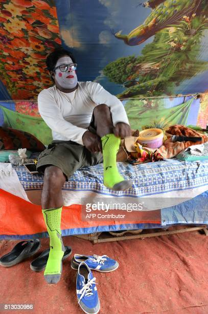 In this photo taken on July 11 Indian peformer Biju Nair gets ready in his clown costume before the Rambo Circus show in Bangalore The 26yearold...