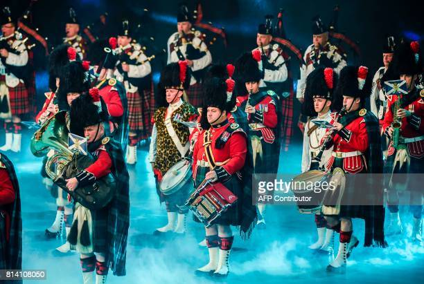 In this photo taken on July 13 the band of The Royal Regiment of Scotland with Pipes and Drums of the 7th Battalion perform during the International...