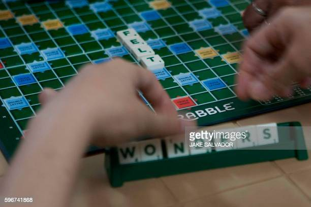 In this photo taken on July 21 2016 showsa residentpatient of a Drug Treatment and Rehabilitation Center playing scrabble during break time in...