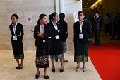 In this photo taken on July 25 Laos students keep watch on the sidelines of the Association of Southeast Asian Nations annual ministerial meeting and...