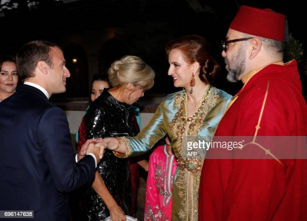 In this photo taken on June 14 2017 Morocco's King Mohammed VI and his wife Princess Lalla Salma welcoming French President Emmanuel Macron and his...