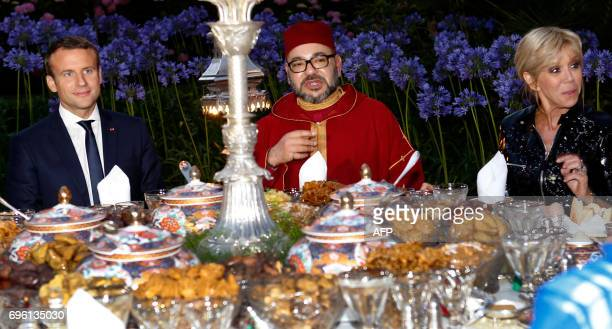 In this photo taken on June 14 2017 Morocco's King Mohammed VI and French President Emmanuel Macron and his wife Brigitte Macron attending an Iftar...