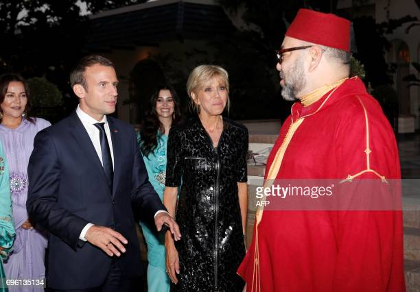 In this photo taken on June 14 2017 Morocco's King Mohammed VI welcoming French President Emmanuel Macron and his wife Brigitte Macron upont their...