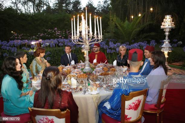 In this photo taken on June 14 2017 Morocco's King Mohammed VI his wife Princess Lalla Salma French President Emmanuel Macron and his wife Brigitte...