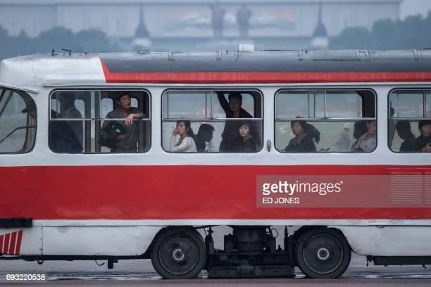 In this photo taken on June 6 commuters ride a tram in Pyongyang / AFP PHOTO / Ed JONES