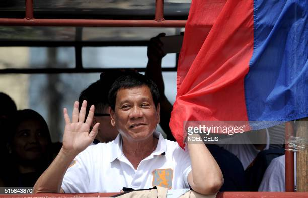 In this photo taken on March 2 shows Davao City Mayor and Presidential Candidate Rodrigo Duterte waves to his supporters during his campaign sortie...