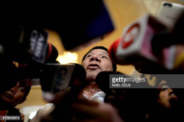 In this photo taken on March 2 shows Davao City Mayor and Presidential Candidate Rodrigo Duterte speaks to reporters during his campaign sortie in...