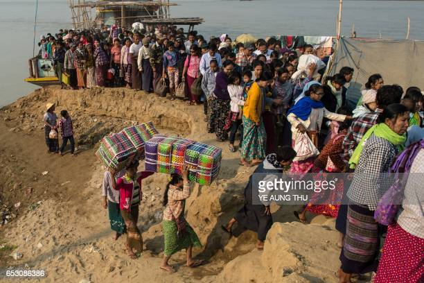 In this photo taken on March 7 people crowd the banks of the Chindwin river in central Myanmar near Pakhangyi town after disembarking from a ferry as...