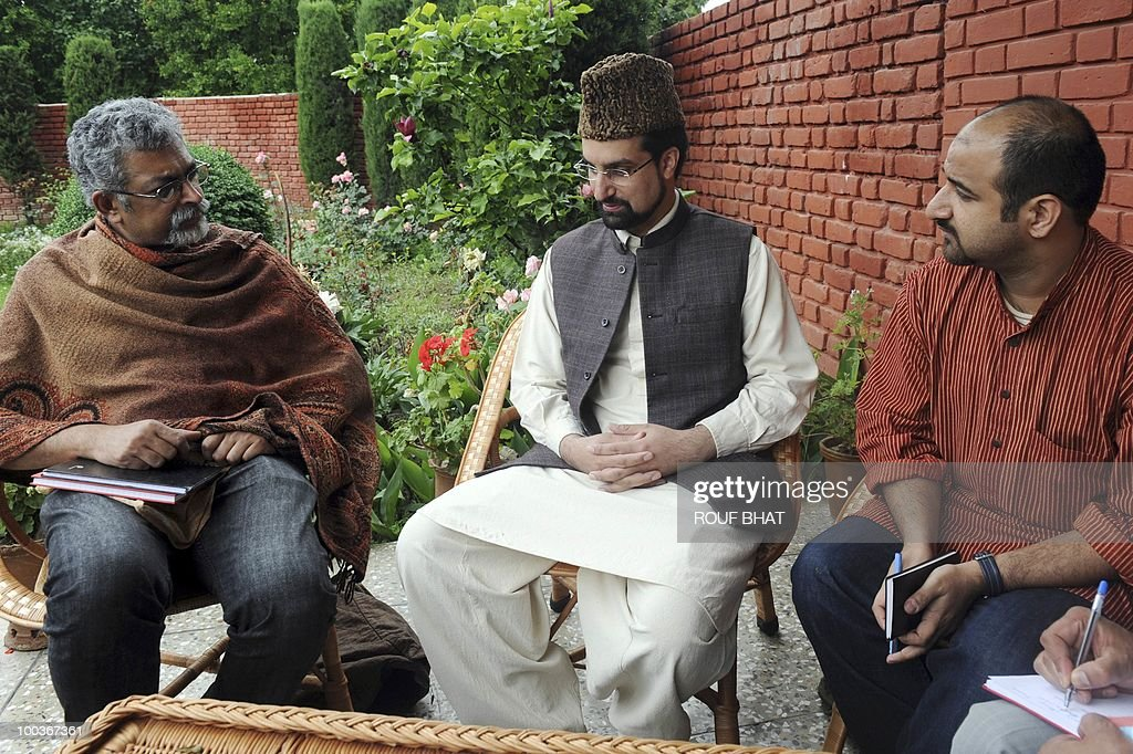 In this photo taken on May 18, 2010, Kashmir's chief priest and chairman of All Parties Hurriyat Conference (APHC) Mirwaiz Moulvi Umar Farooq (C) is flanked by Amnesty International representatives Ramesh Gopalakrishnan (L) and Bikramjeet Batra (R) during a photo session in Srinagar. Rights watchdog Amnesty International concluded on May 22, 2010 its first visit to strife-torn Kashmir since an armed insurgency against Indian rule engulfed the region more than 20 years ago. The team said it held discussions with senior state government officials, separatist leaders and a host of NGOs including local rights groups. It also 'conducted research' into cases of preventive detention, but a request to visit detainees in the main jail of Indian Kashmir's summer capital Srinagar was denied. AFP PHOTO/Rouf BHAT