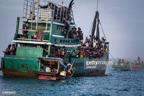 In this photo taken on May 20 2015 shows Rohingya migrants resting on a boat off the coast near Kuala Simpang Tiga in Indonesia's East Aceh district...