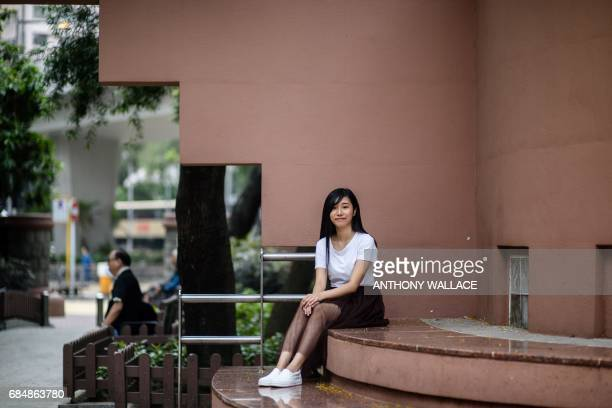 In this photo taken on May 9 20 year old student Chau Hooi who works with prodemocracy party Demosisto poses in a park in the Prince Edward district...