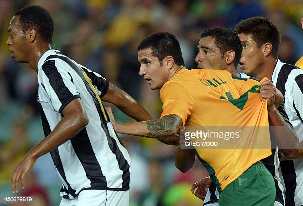 In this photo taken on November 19 2013 Australian football player Tim Cahill is marked by opponents as they wait for a corner kick to be taken...