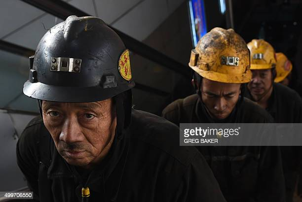 In this photo taken on November 20 coal miners exit a mine after their shift underground at Datong in China's northern Shanxi province A Chinese...