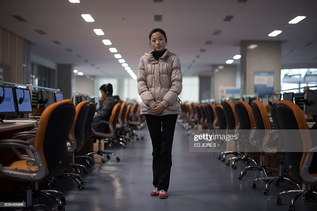 In this photo taken on November 26, 2016, 19-year-old volunteer staff member Ri Young-Hwa (Lee Young-Hwa) poses for a photo in a study room at SciTech science centre in Pyongyang. / AFP / Ed JONES / This photo package is accompanied by a blog piece written by staff photographer Ed Jones https://goo.gl/lEZ8Fk