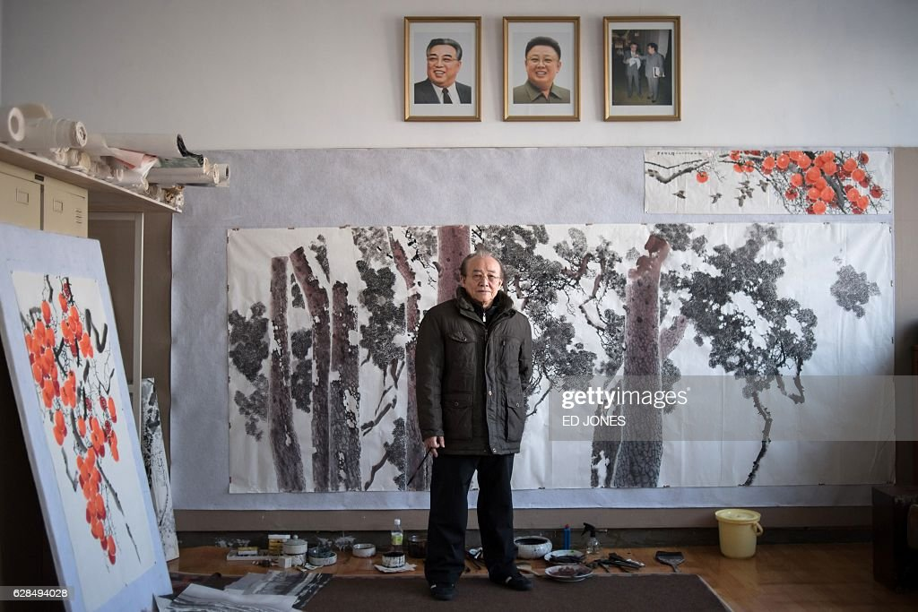 In this photo taken on November 28, 2016, artist Ri Gyong-Ran (Lee Gyung-Lan) poses for a photo at the Mansudae Art Studio where he works in Pyongyang. / AFP / Ed JONES / This photo package is accompanied by a blog piece written by staff photographer Ed Jones https://goo.gl/lEZ8Fk
