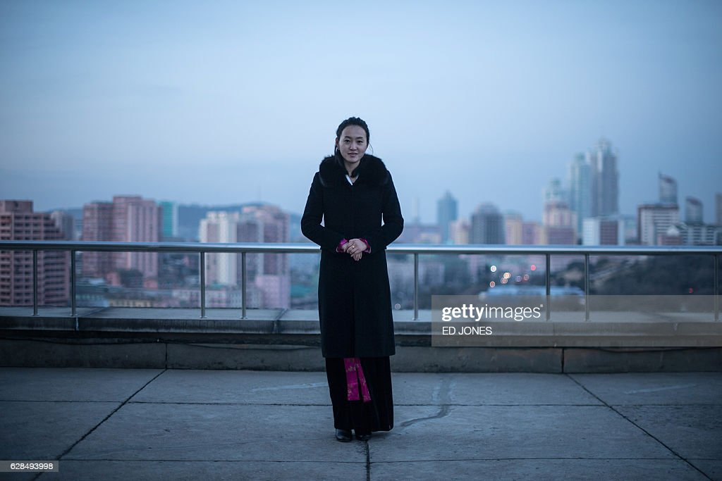 In this photo taken on November 29, 2016, tour guide Jeon Eun-Mi poses for a photo atop the Arch of Triumph where she works in Pyongyang. / AFP / Ed JONES / This photo package is accompanied by a blog piece written by staff photographer Ed Jones https://goo.gl/lEZ8Fk