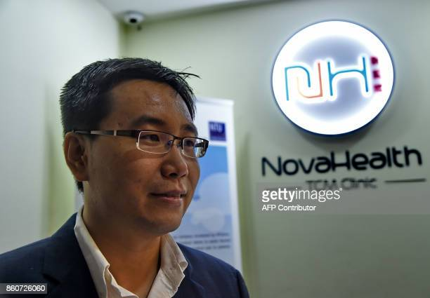 In this photo taken on October 12 Zhang Yizhong CEO of AliTreat the robotics startup of Nanyang Technological University that developed the Robot...