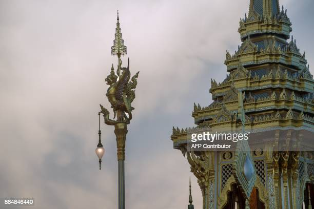 In this photo taken on October 21 2017 adorning light posts stand next chambers of the royal pavilion where Thailand's late king Bhumibol Adulyadej...