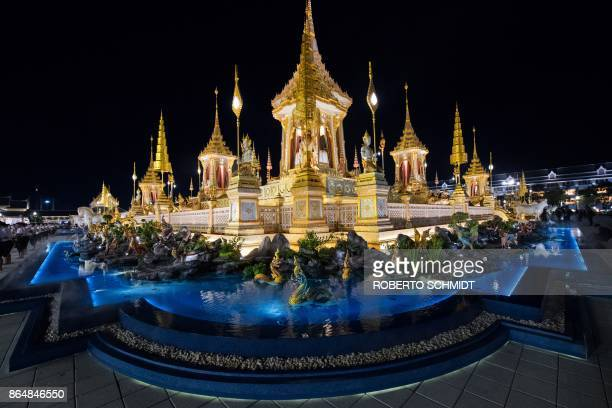 In this photo taken on October 21 2017 mythical figures adorn a shallow pool around the pavilion where Thailand's late king Bhumibol Adulyadej will...