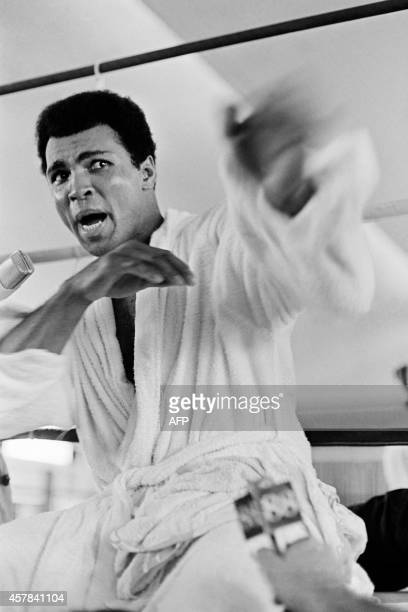 In this photo taken on October 27 1974 US boxing heavyweight champion Muhammad Ali gestures during a press conference three days before the heavy...