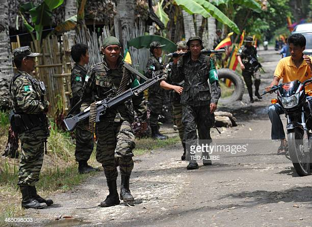 In this photo taken on September 5 2011 Moro Islamic Liberation Front rebels patrolling inside camp Darapanan in Sultan Kudarat province in southern...