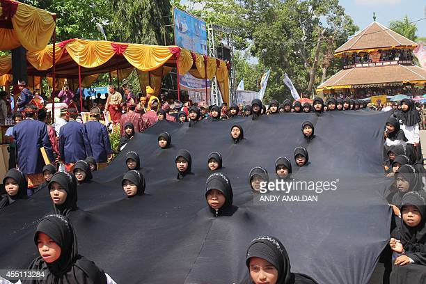 In this photo taken on September 7 children perform during a royal festival locally called the '19th Festival Kraton Nusantara' in Bima on Sumbawa...
