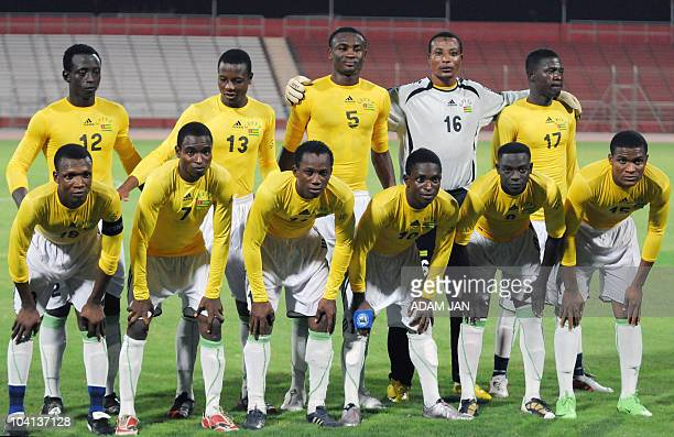 In this photo taken on September 7 football players claiming to represent Togo for an international friendly match against Bahrain pose for a...