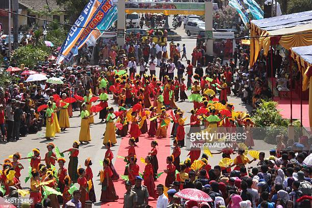 In this photo taken on September 7 Indonesian women perform traditional dance during a royal festival locally called the '19th Festival Kraton...