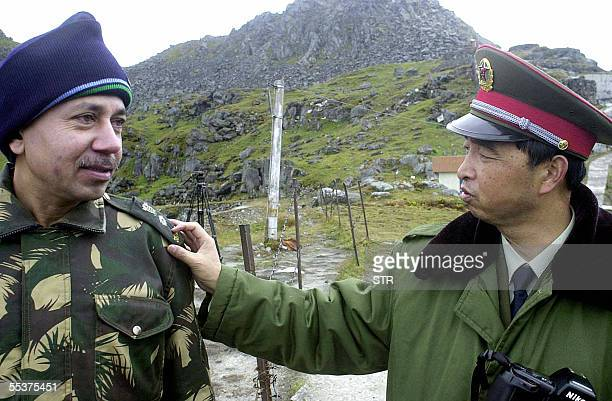 STORY 'INDIACHINANORTHEASTTRADE' In this photograph dated August 2003 a Chinese soldier interacts with an Indian soldier at the Nathu La Pass area at...