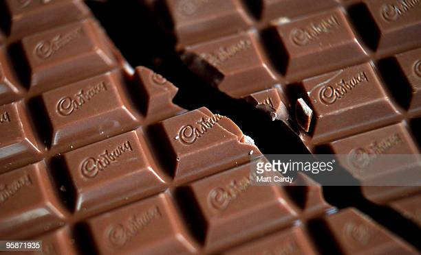 In this photograph illustration a bar of Cadbury's Dairy Milk chocolate is broken in half on January 19 2010 in Bristol England The US food giant...