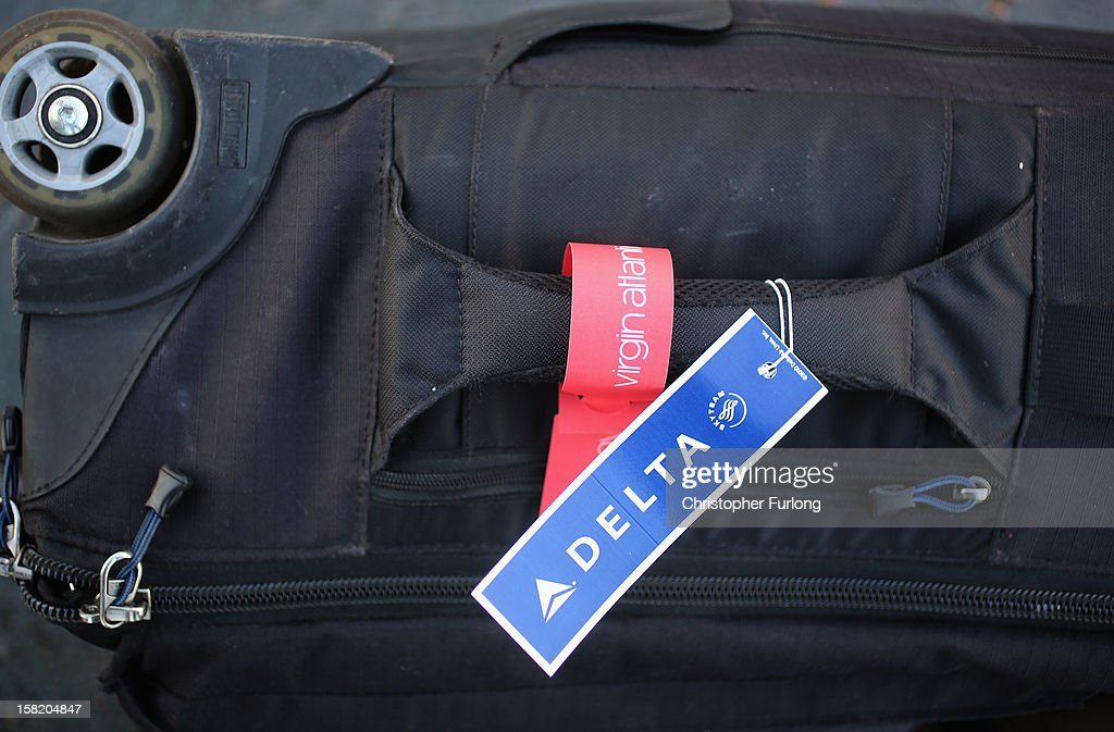 In this photograph illustration a Virgin Airlines and Delta Airlines baggage tags are affixed on the handle of luggage on December 11, 2012 in Manchester, England. Delta Air Lines has agreed to invest $360m (£224m) to buy the 49% stake of Singapore Airlines in Virgin Atlantic. The airlines hope the new joint venture will create an expanded trans-Atlantic network.